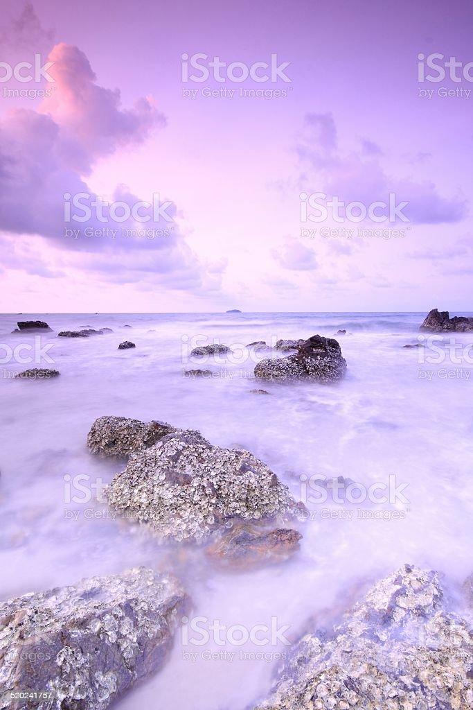 long exposure of sea and rocks stock photo