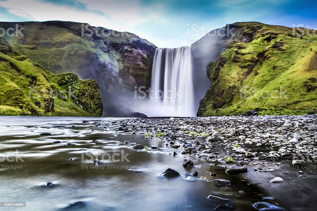 Long exposure of Skogafoss waterfall in Iceland at dusk stock photo