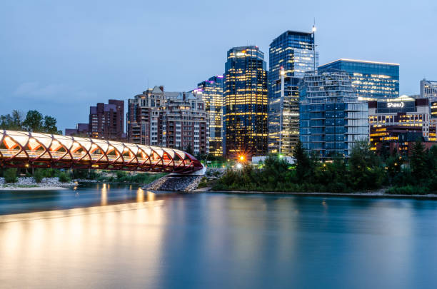 Long exposure of the Calgary skyline over Bow River stock photo