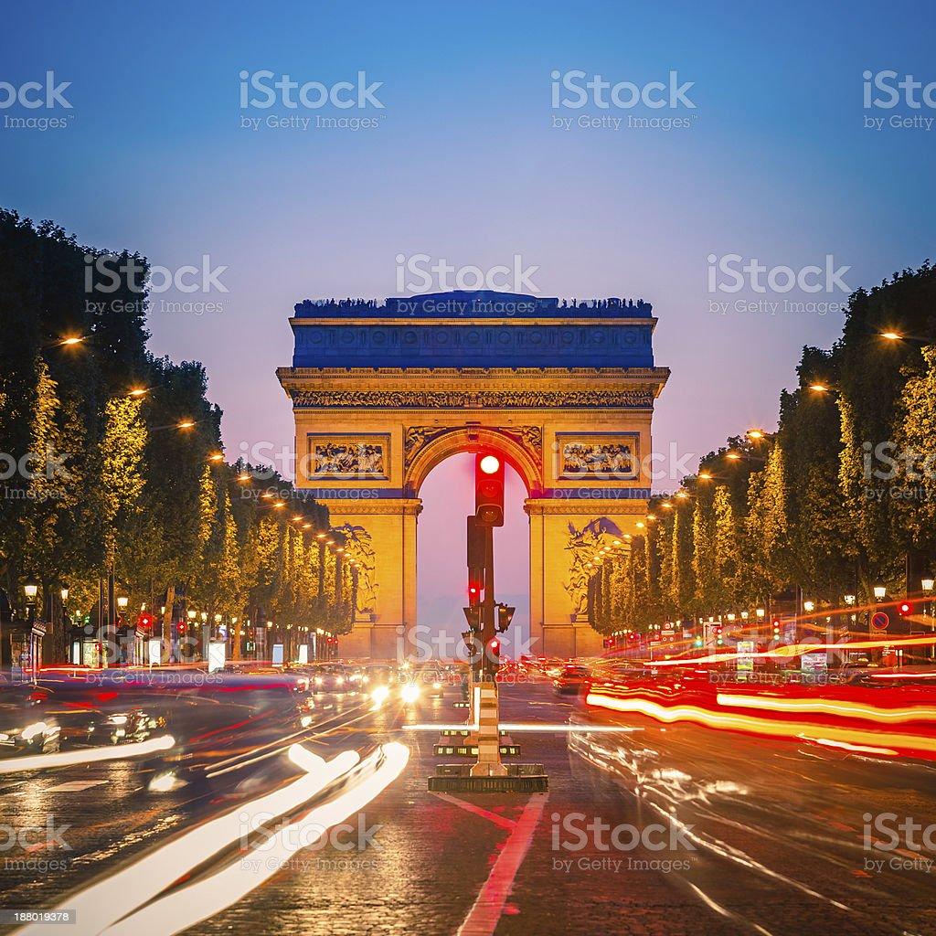 Long exposure photo of the Arc de Triomphe, Paris at night  stock photo