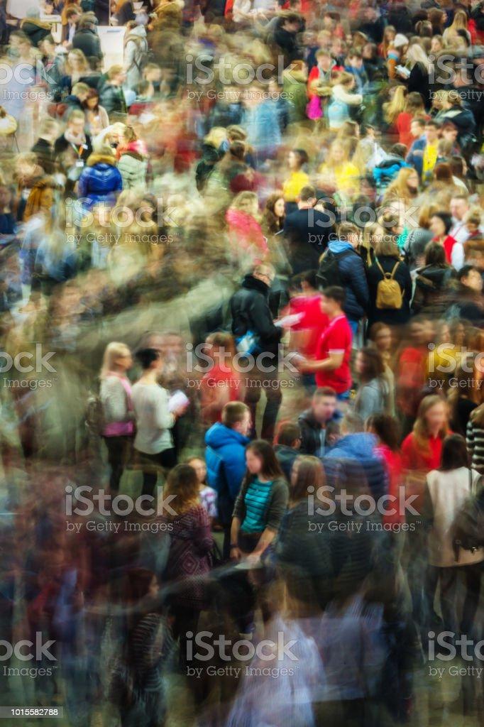Long exposure photograph of people in an art fair, studies fair, motion blur, moving people, crowd - fotografia de stock