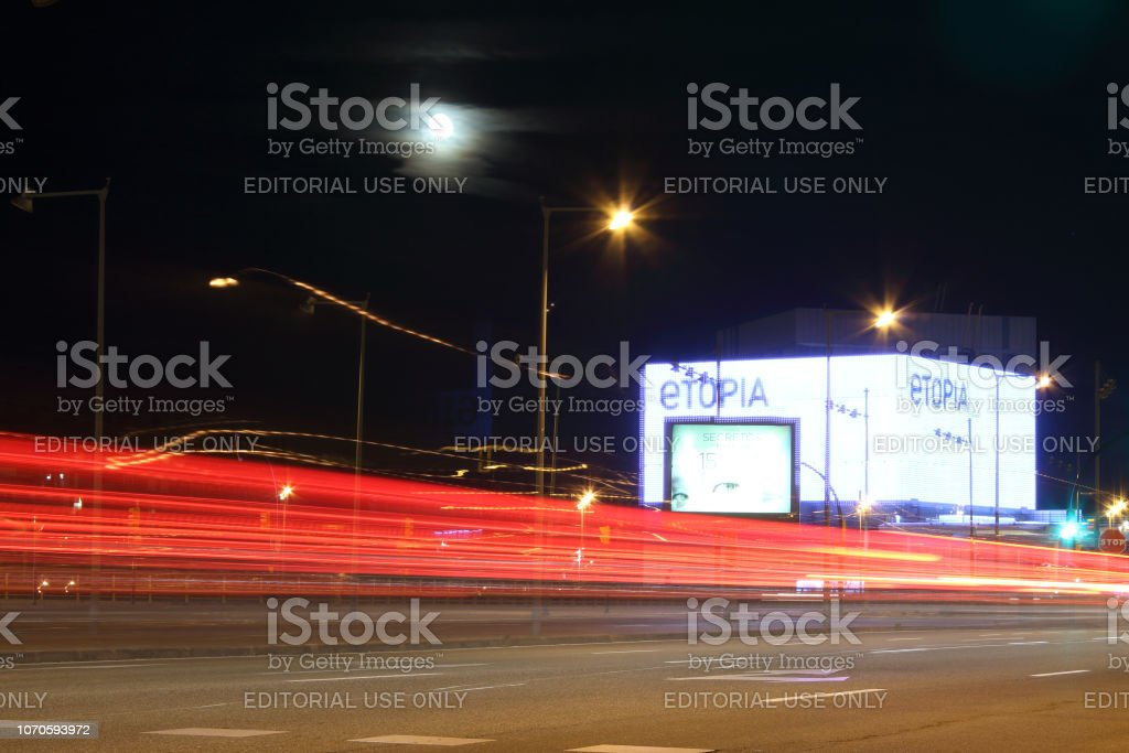 Long exposure red light trails of position and stop rear lamps during...