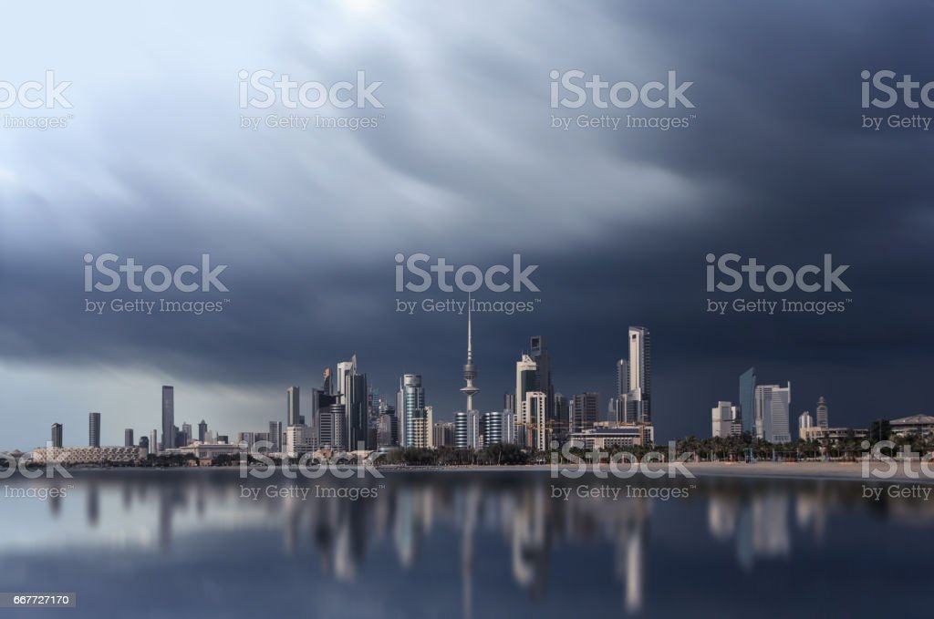 long exposure shot of kuwait city skyline during a cloudy day stock photo