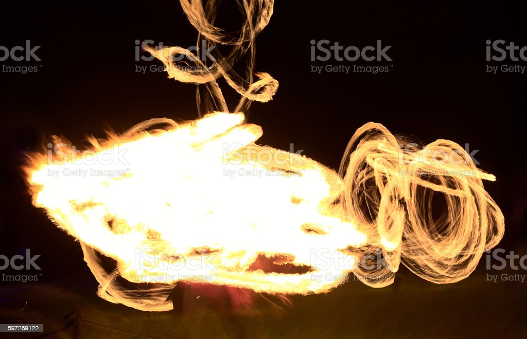 Long exposure shot of moving burning torches and fire royalty-free stock photo