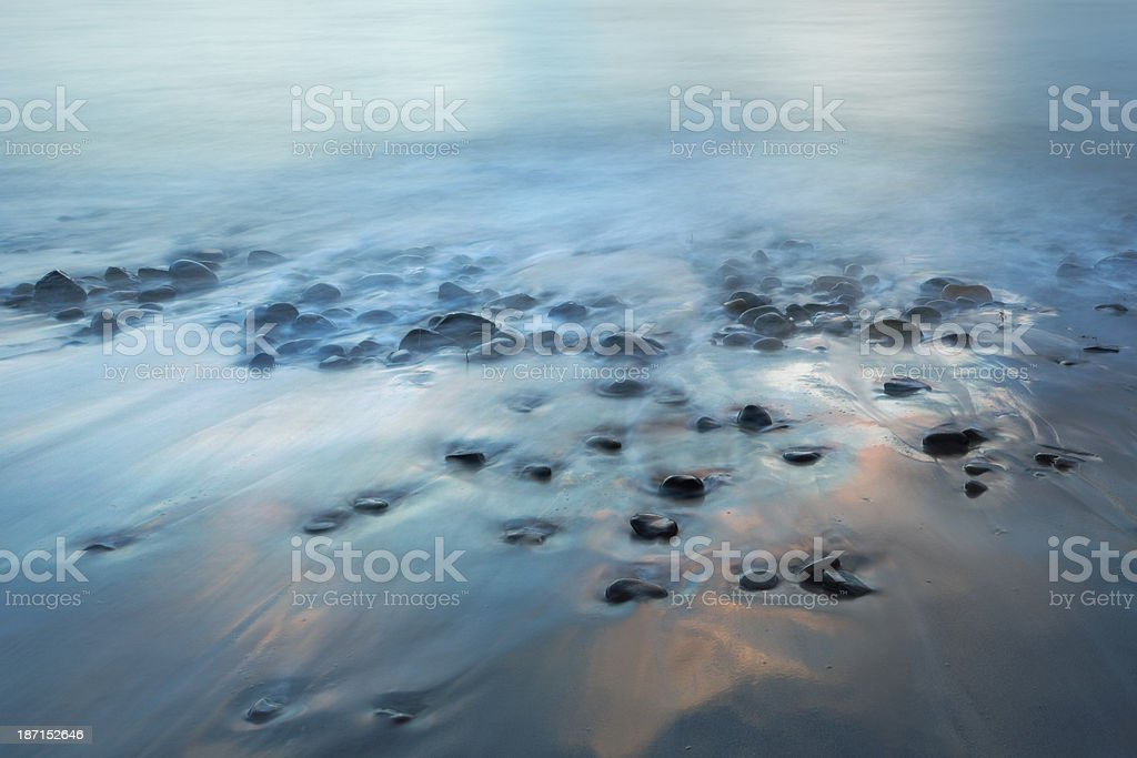 long exposure shot of stones in the sea royalty-free stock photo
