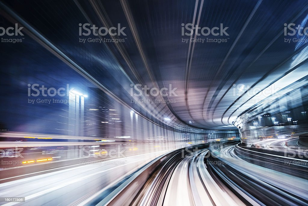 Long exposure speed through lighting from a commuter train stock photo
