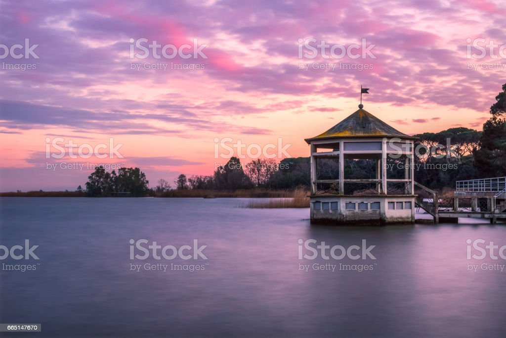Long exposure sunset over a lake stock photo