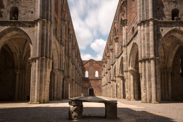 Long exposure view of ancient S Galgano Abbey (Tuscany, Italy), with the open rooftop showing moving clouds stock photo