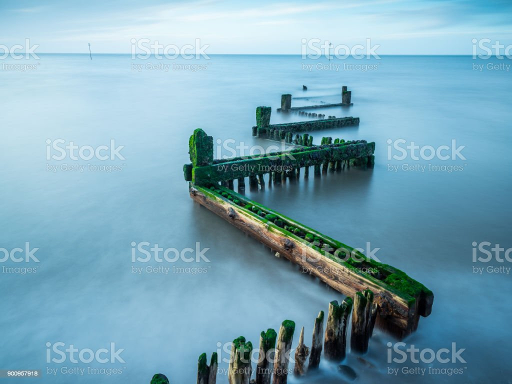 Long exposure wooden sea defence groyne stock photo