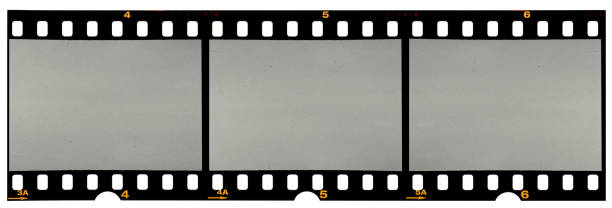 long film strip, blank photo frames, free space for your pictures, real high-res 35mm film strip scan with signs of usage on white background - film industry stock pictures, royalty-free photos & images