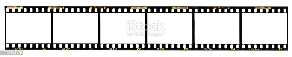 1125303139 istock photo long film strip, blank photo frames, free space for your pictures, real high-res 35mm film strip scan with signs of usage on white background 1125303176