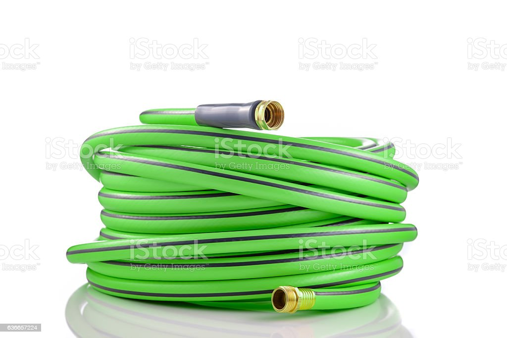 Long garden hose rolled-up isolated on white background stock photo