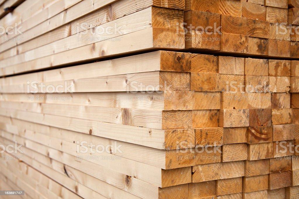 Long, geometrically stacked lumber royalty-free stock photo