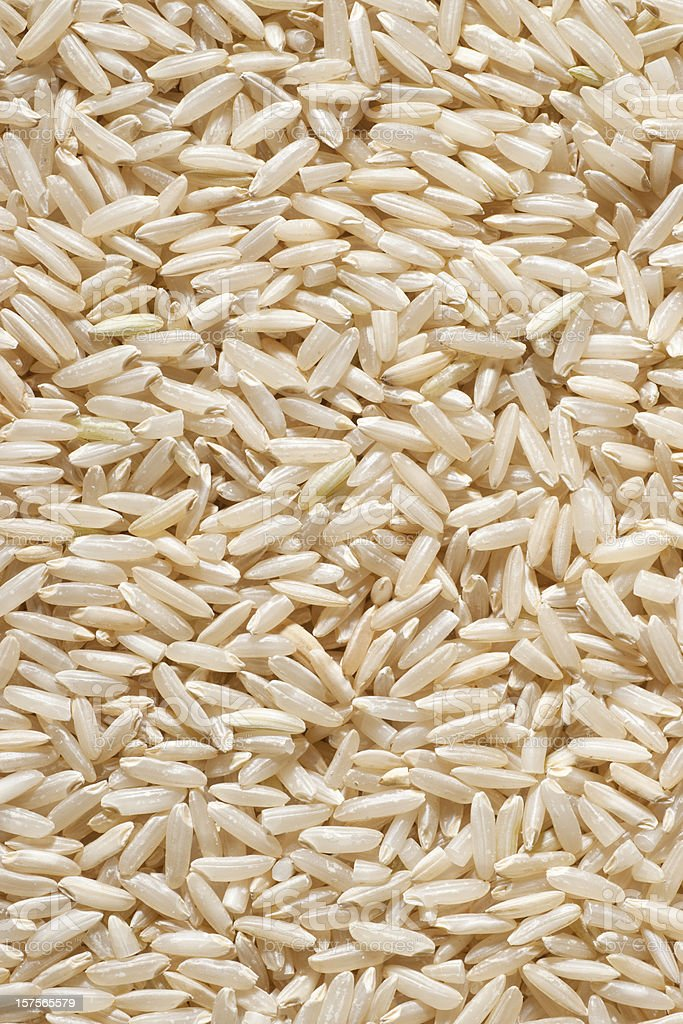 long grain brown rice background royalty-free stock photo