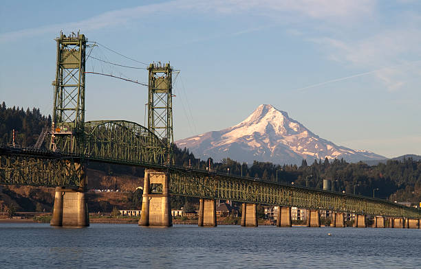 Long green bridge over Columbia to Hood River Oregon The draw bridge takes you across the Columbia River to Hood River Oregon in the Shadow of Mt Hood hood river valley stock pictures, royalty-free photos & images