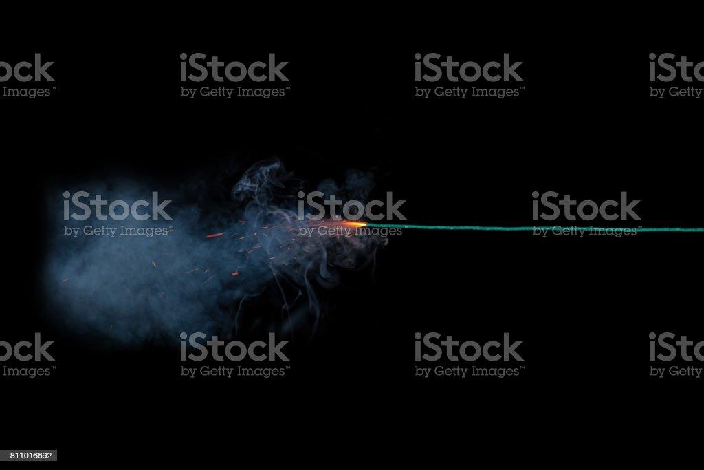 Long green fuse burning on black background isolated royalty-free stock photo