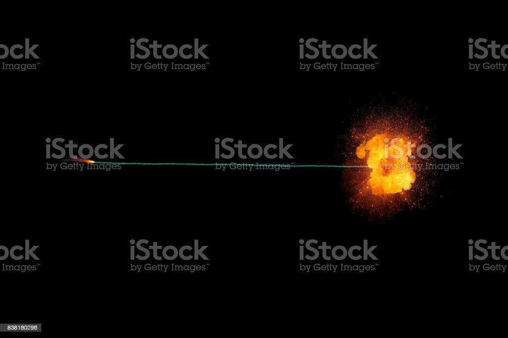 Long green fuse burning on black background isolated stock photo