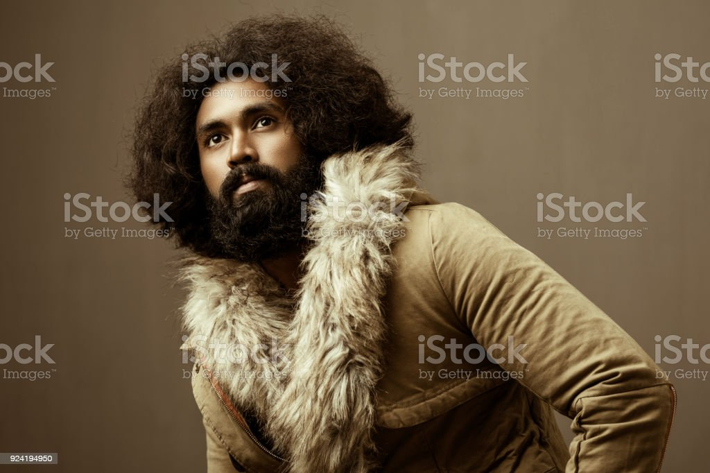 Long hair and bearded young man with winter concept stock photo
