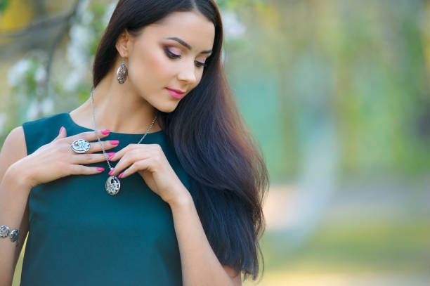 long hair beautiful european woman with luxury accessory. Close-up beauty portrait with jewelry stock photo
