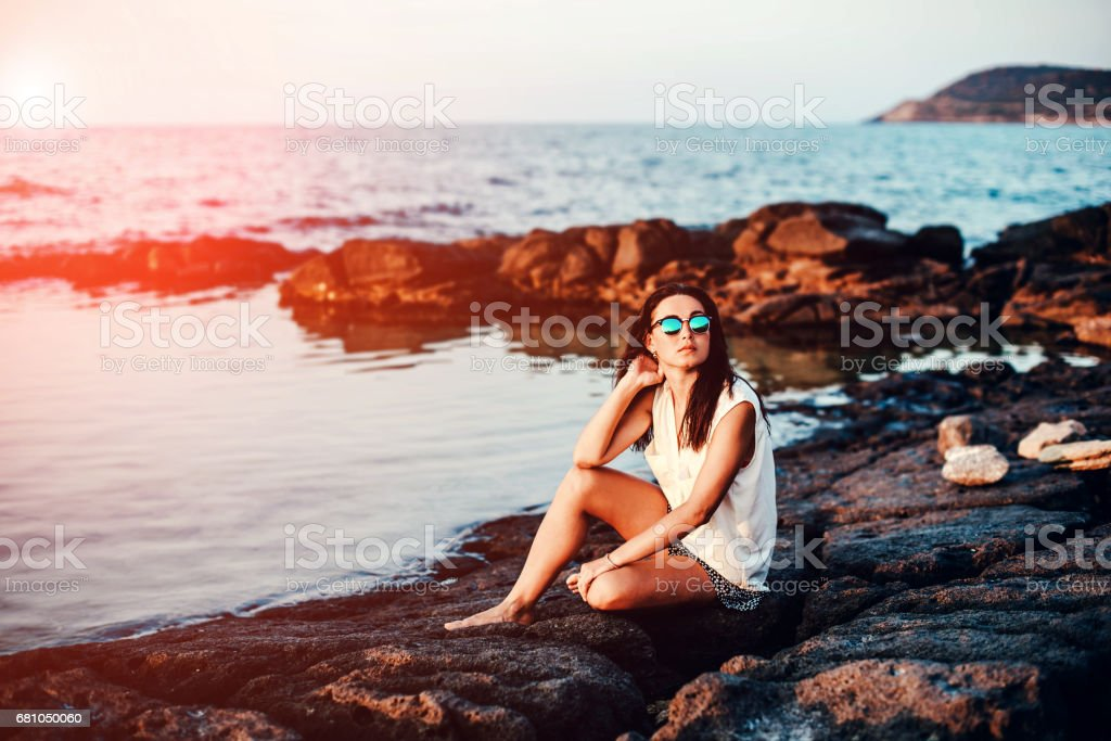 Long hair brunette girl relaxing in the stones royalty-free stock photo