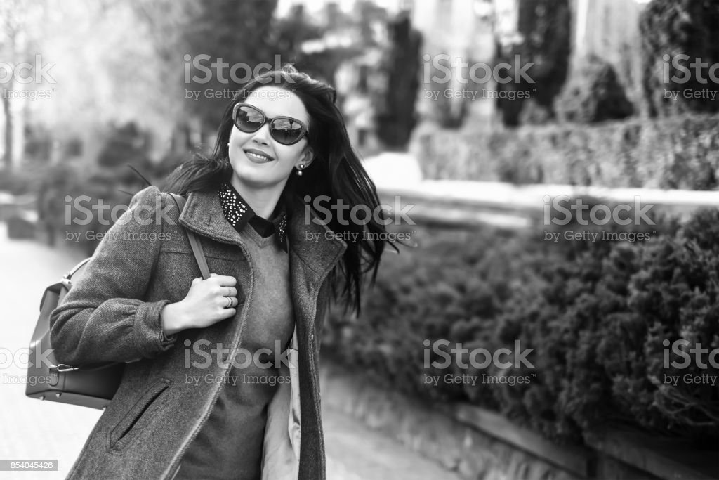 Long hair brunette girl walking outdoor stock photo