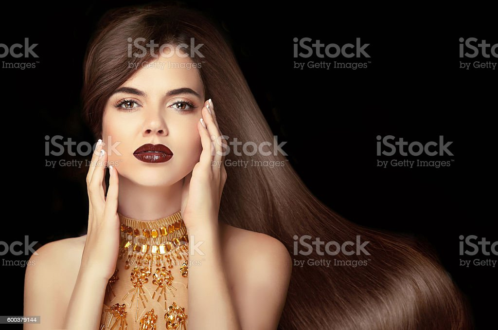 Long hair. Brunette girl with shiny wavy hairstyle. vogue stock photo