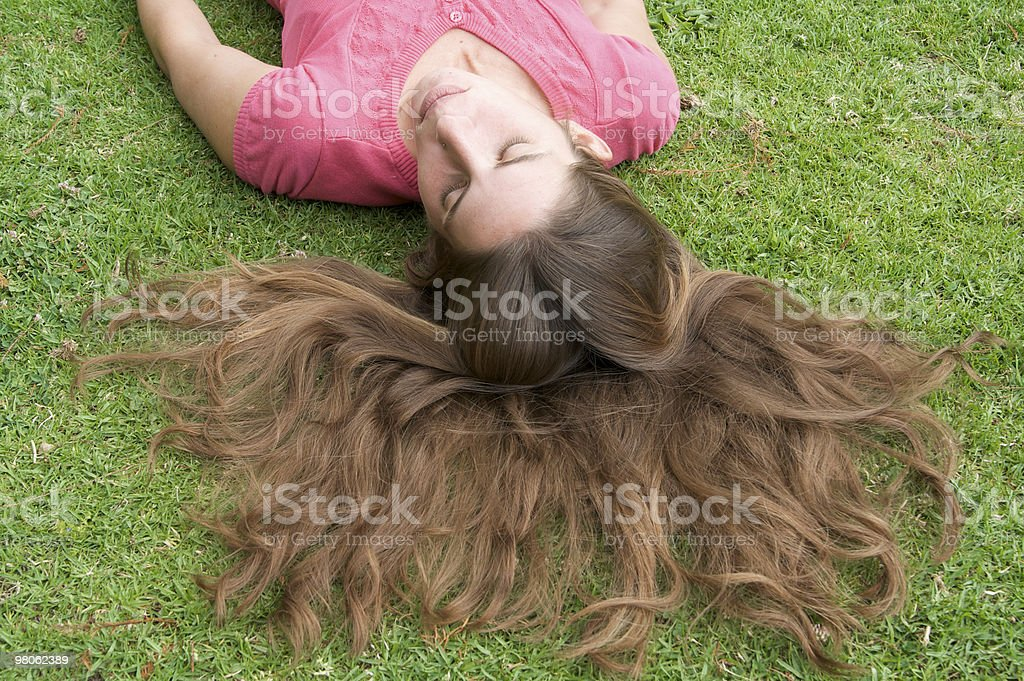 Long Hair Fanned Out in the Grass royalty-free stock photo