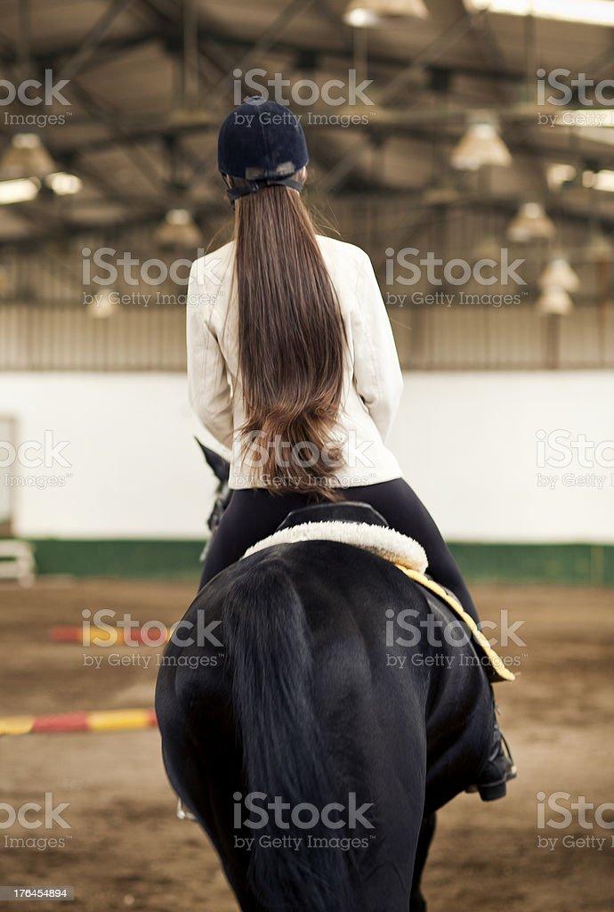 long hair girl riding horse stock photo