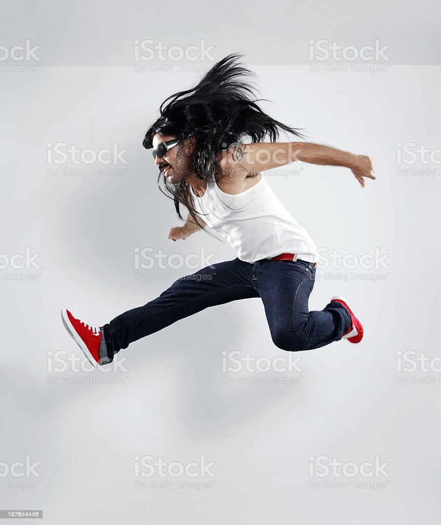 Long Hair Rocker Jump stock photo