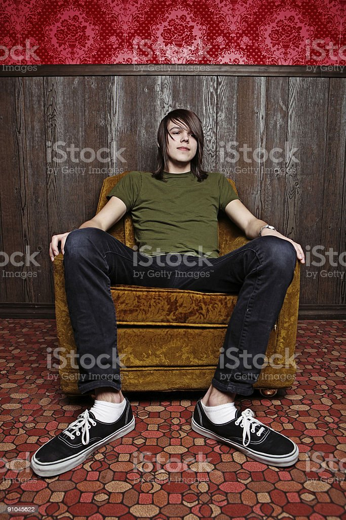 Long Haired Male Sitting in Retro Room royalty-free stock photo