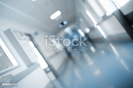 istock Long hall of medical building, unfocused background 858504474