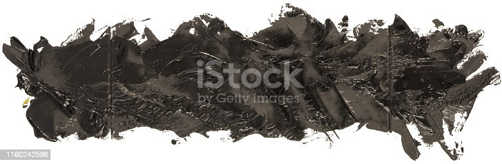 850235550 istock photo Long hand drawn isolated paintbrush stripe with dirty black color 1160242586