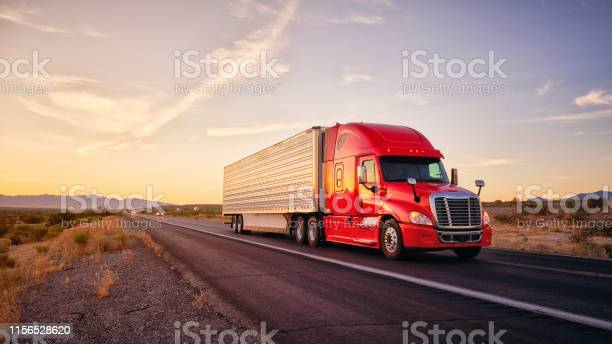 Photo of Long Haul Semi Truck On a Rural Western USA Interstate Highway