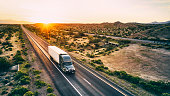 istock Long Haul Semi Truck On a Rural Western USA Interstate Highway 1213063560