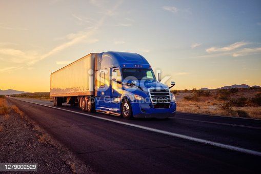 istock Long Haul Semi Truck On a Rural Western USA Interstate Highway 1279002529
