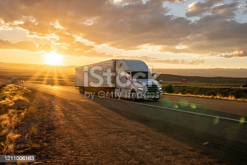 Big freight truck on the open highway heading to their destinations to make the deliveries