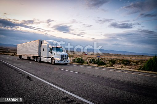 Big freight trucks on the open highway heading to their destinations to make the deliveries