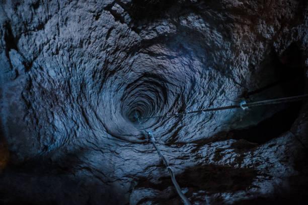 Long hole tunnel through gypsum mine in Cappadocia, Turkey. stock photo