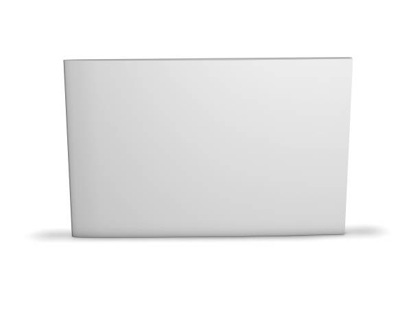 Long horizontal booklet with blank cover standing on floor with shadow. stock photo