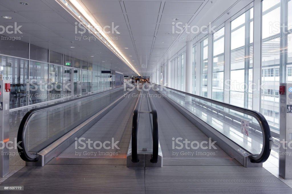 long horizontal escalator at international airport terminal stock photo