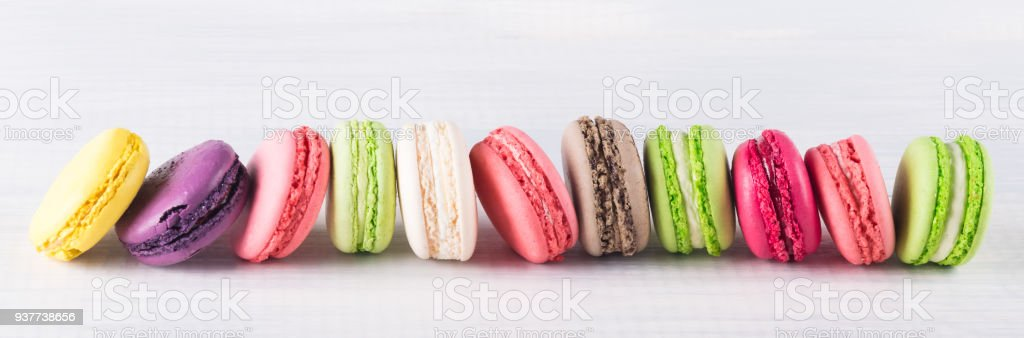 Long Horizontal Row Of Colorful Bright Biscuits On White Background