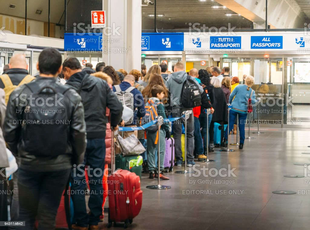 Long immigration queue at Malpensa Airport in Milan, Italy for arrivals of Non-Schengen travellers stock photo