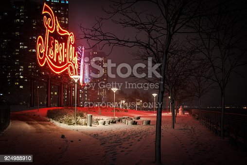 istock Long Island City during winter storm. View of Gantry State Park and Pepsi Cola logo. 924988910