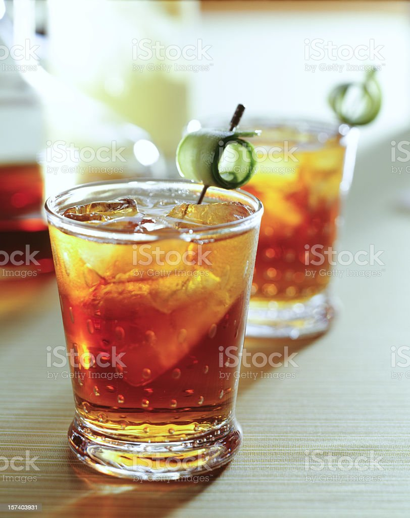 Long Island Iced Tea with hollowed out olive looking things stock photo