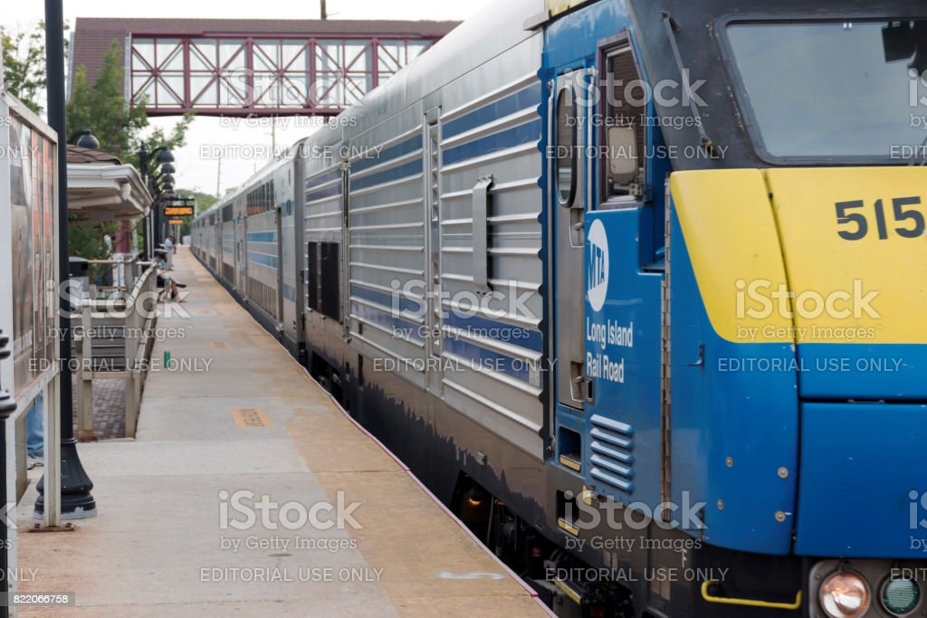 Long Island Railroad Train arriving at the station stock photo