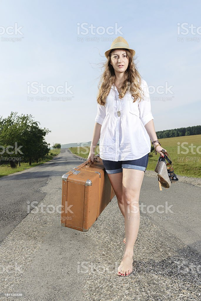 Young tired woman with suitcase