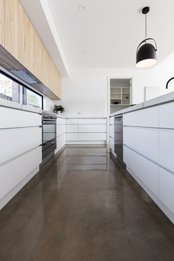 Long kitchen with polished concrete floor