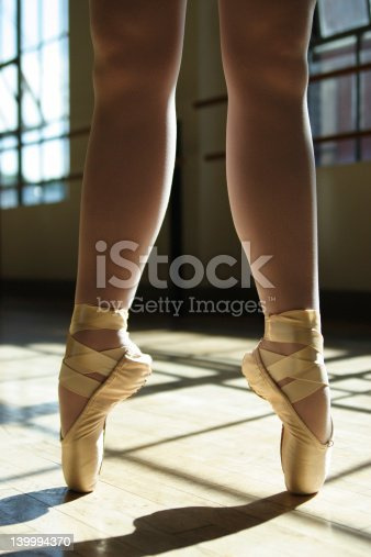 istock Long Legs in Ballet Shoes 139994370