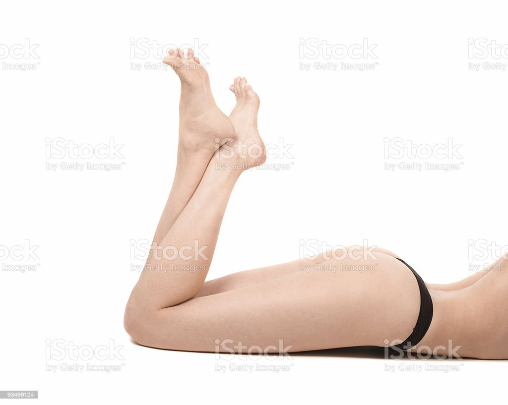 Long legs of relaxed lady in black lingerie royalty-free stock photo