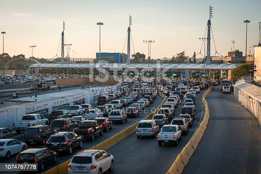 Long lines of cars on the Mexican side of the border wait to cross from Tijuana to San Ysidro, California. This is one of the busiest border crossings in the world. (Tijuana, Mexico - March 21, 2015)